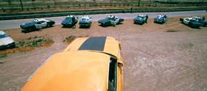 "One of the many times the 1973 Ford Mustang confronts a lineup of squad cars in ""Gone in 60 Seconds""."