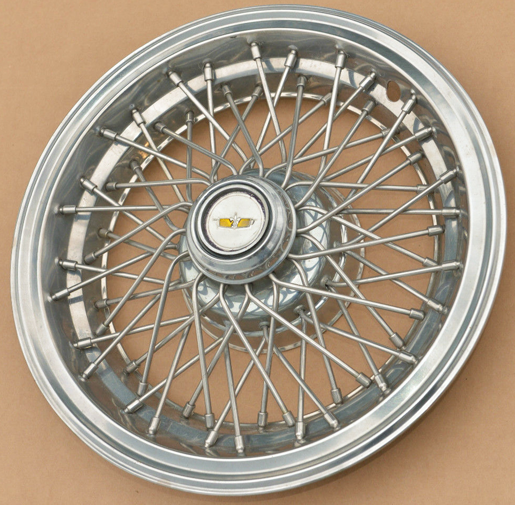 This 15-inch wire wheel cover was used by General Motors from 1978 through the 1990s on Chevrolet, Pontiac, Buick, and Oldsmobile full and midsize rear-wheel-drive models.