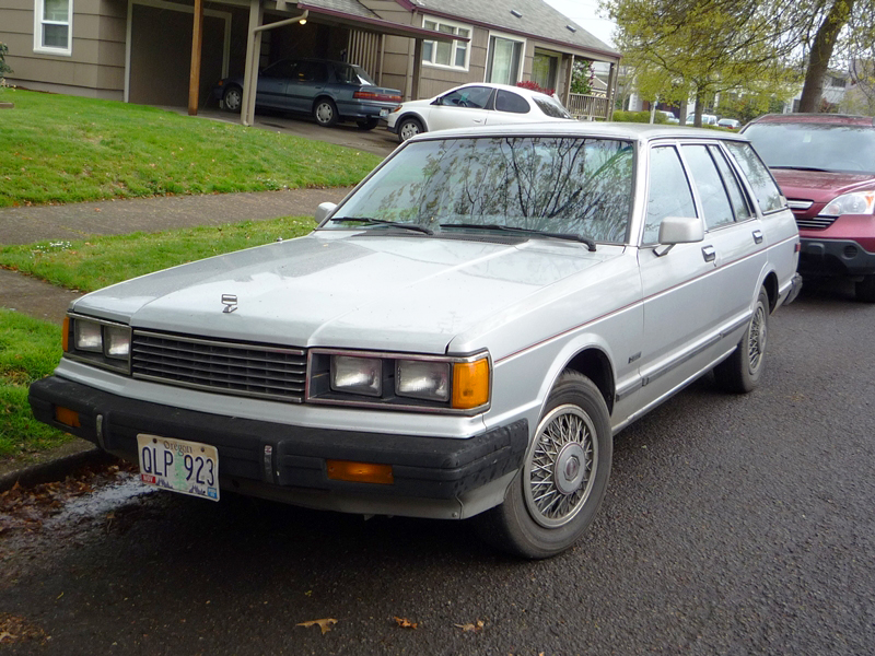A better view of a 1982 Datsun Maxima wagon equipped with wire wheel covers shown in the prior photo.  They were not offered on sedans.