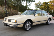 A 1987 Olds 98 model equipped with the wire wheel covers shown in the prior two pics.  GM sister cars Buick Electra/LeSabre and Pontiac Bonnevilles wore revised versions of these.
