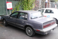 1986-90 Buick Skylarks (1989 shown) and 1986-88 Olds Calais compact FWD models used 13-inch versions of the wire wheel cover shown in the prior photo.