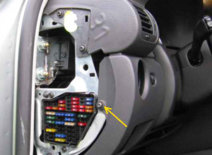 Most automotive fuses are grouped together behind a removable plastic panel located under the dash, or on the edge of the dash as shown in this photo.