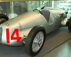 Auto Union began working on Grand Prix race cars in 1933, which saw their first racing season for 1934. Initial TYPE A and TYPE B models featured V12 engines, and garnished many racing victories. TYPE Cs featured a V16 engine, while final TYPE Ds used mostly V12s (and were equipped with dual rear wheels). This model shown is a 1938 TYPE D built with an earlier C V-16 engine.  (Photo credit: Sean Connor)