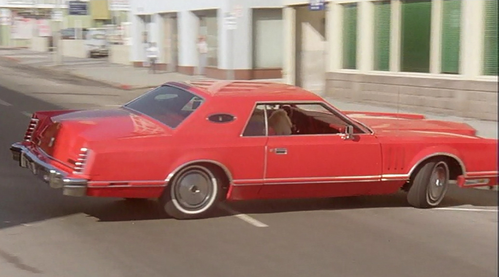 red 1977 Lincoln Mark V, plain roof