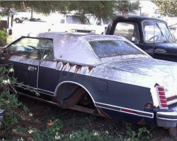 1979 Lincoln Mark V Bill Blass edition rusted in junk yard