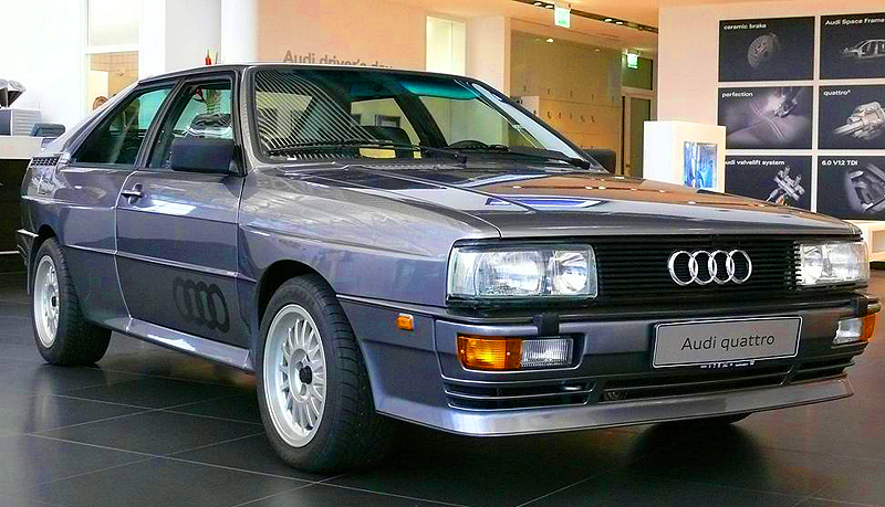 The Coupe Quattro was the first Audi to feature the Quattro full time all-wheel-drive system.  However the Coupe Quattro was not imported to the United States until the 1983 model year with a turbocharged version of the five-cylinder standard (130 horsepower).  Shown is a European market version.  (Photo credit: Sean Connor)