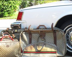 A 1979 Seville Gucci edition shown with the matching set of fitted luggage that came standard with the package.  (Photo credit: R. Stisman)