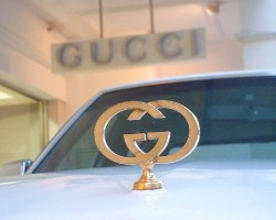 Gucci Edition Sevilles were equipped with 24 karat gold trim, including hood ornaments. (Shown: a 1978 Seville Gucci Edition in front of a Gucci outlet in Queensland, Australia in 2002)  Photo credit: Gucci Group, Australia