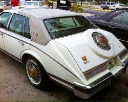 "Some 1980-84 Seville Gucci editions were equipped with chrome ""straps"" on the trunklid, and others like this '83 were equipped with simulated spare tire humps.  (Photo credit: M. Bailey)"