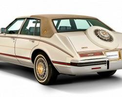 In 1980, the Cadillac Seville was redesigned. Although virtually the same dimensions as the previous 1976-79 model, the new design now featured front-wheel-drive and angled rear trunk styling based on Rolls Royces of earlier decades.  (Photo credit: The Gucci Museum)
