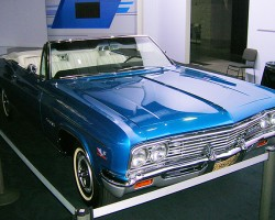 Next to its upcoming 2014 Impala, Chevrolet displays a classic 1965 Impala SS convertible.  (Photo credit: Sean Connor)