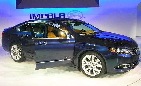 A new Chevy Impala goes on sale next spring as a 2014 model. With 4- and 6-cylinder choices, buyers can opt for up to 35mpg.  (Photo credit: Sean Connor)