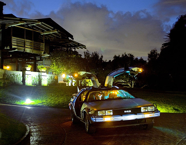 An original DeLorean fitted for use in the 1985 movie Back To The Future. Behind the car is Dr. Emmett Browns house (played by Christopher Lloyd)   Photo credit: DeLorean Motor Company