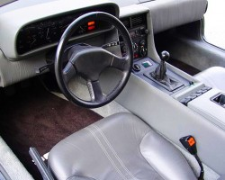 A view of a stock 1981-83 DeLorean DMC-12 interior equipped with 5-speed manual. Credit: DeLorean Motor Company