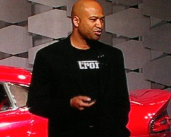 Wearing a Detroit logo shirt printed in Ferrari font, Chrysler SRT Performance Group chief Ralph Gilles introduces the new 2013 Dodge Viper.  (Photo credit: Sean Connor)