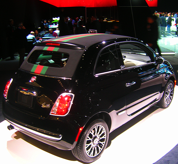 Fiat introduces its 500 Gucci Edition. Convertible top, leather interiors and even seat belts all prominently display Gucci pattern stripes.  (Photo credit: Sean Connor)