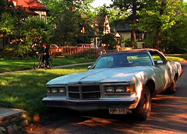 Corey Haim (Lucas) rides his bike over to his love interest's house and, after seeing this particular car parked in front, comes to the cold realization that the coolest kid in his high school (played by Charlie Sheen) is already there edging him out.  (Photo credit: imcdb.org)