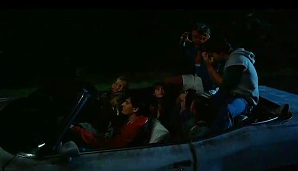 Anyone who had a convertible as a teenager can appreciate this scene where Charlie Sheen piles all his buddies in the '75 Grand Ville convertible and goes recklessly cruising.  (Photo credit: imcdb.org)