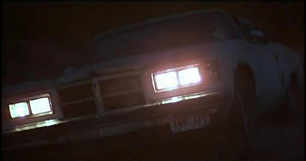 Charlie Sheen's character runs into some trouble on the road, sliding his '75 Pontiac Grand Ville into a ditch.  (Photo credit: imcdb.org)