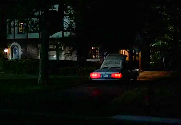 "In this scene, Charlie Sheen puts the top down on his '75 Pontiac Grand Ville as he and his girlfriend (played by Courtney Thorne-Smith) argue and break up.  The Thompson Twins ""King For A Day"" plays in the background.  (Photo credit: imcdb.org)"