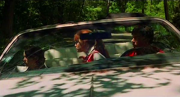 Winona Ryder, Kerri Green, and Charlie Sheen in the '75 Pontiac Grand Ville.  (Photo credit: imcdb.org)