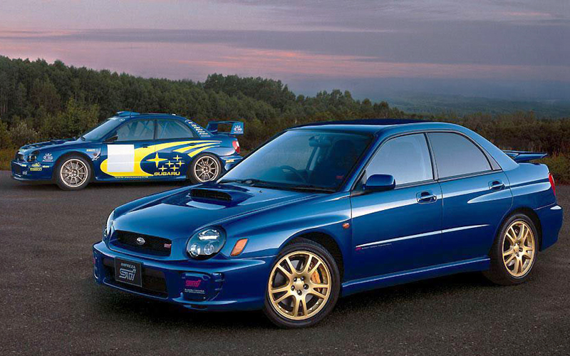 2002 - 2007 Subaru WRXs are high-powered versions of the companys base Impreza. Featuring all-wheel-drive and a four cylinder engine of 227+ horses, these cars have a strong fan base that will keep prices of good examples high.  The 2006 WRX STi version is shown here.  (Photo credit: Subaru of America)