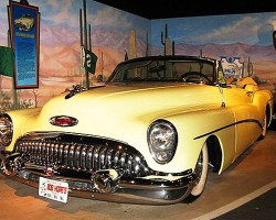 The 1953 Buick Skylark convertible that once belonged to entertainer Bob Hope.  Golf and Oscar awards are the theme of this display - two things the actor was well known for.  (Photo credit: Hollywood Star Cars Museum)