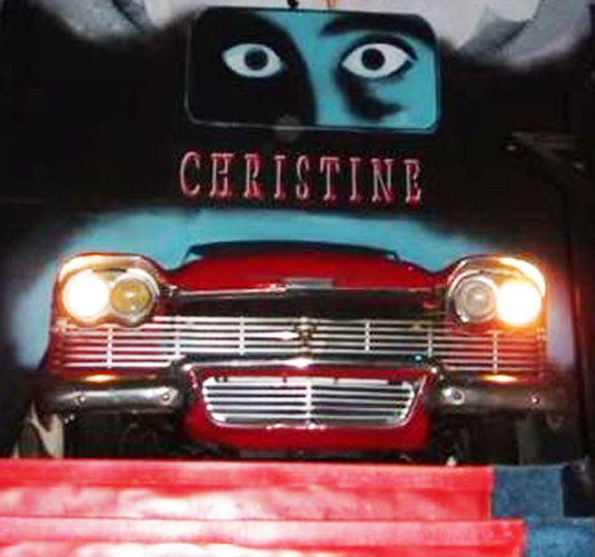 This second floor display of one of the two dozen 1958 Plymouth Furys used in the movie CHRISTINE awakens when a motion detector senses guests approaching up the steps. Headlights come on and engine rev sounds are heard.  Photo credit: Hollywood Star Cars Museum)