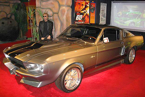 """Eleanor"" - one of the twelve '67 Ford Mustang Shelby GT500s used in the remake of Gone In Sixty Seconds.  A mockup of Nicholas Cage is in the background.  Only 7 of these cars survive today. (Photo credit: Hollywood Star Cars Museum)"