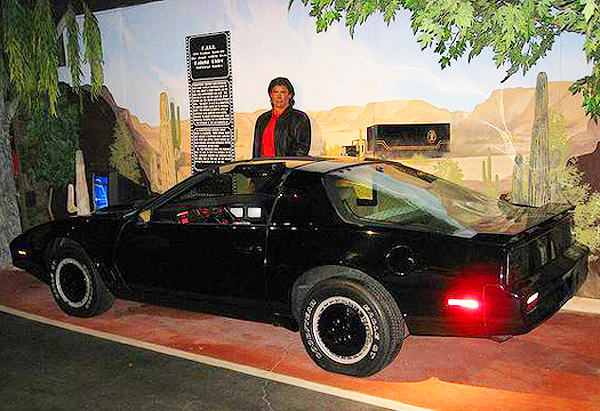 A mockup of David Hasselhoff stands behind one of the many 1982-83 Pontiac Trans Ams used in the filming of Knight Rider tv series.  (Photo credit: Hollywood Star Cars Museum)
