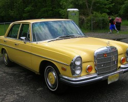 yellow 1970 Mercedes 280SE