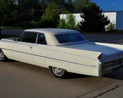 Like most coupes of the era, this 1963 Cadillac Coupe de Ville is equipped with a vinyl roof covering that goes to great lengths to simulate the look of a convertible top.  (Photo credit: Collectioncar.com)