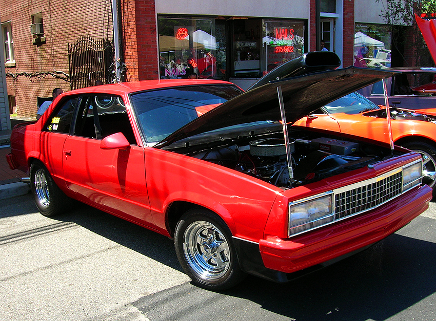 A 1980 Chevrolet Malibu coupe, retrofitted with a front end clip from a later 1982-83 model (coupes were not offered after '81). Headlights are further customized also.  (Photo credit: Sean Connor)