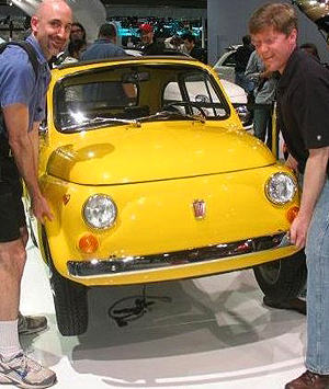 The original Fiat 500 was sold from 1958 - 1975.  It is so small and light weight that two adults can lift the front end off the ground.  (1970 model shown).  Photo credit: Biff Leonard