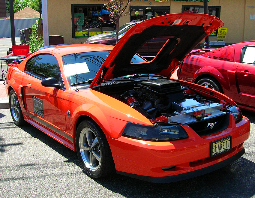 "A 2004 Ford Mustang ""competition orange"" limited-edition Mach 1 coupe, one of 7,182 built.  (Photo credit: Sean Connor)"
