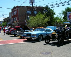 "Dozens of classic cars from a 1915 Ford Model T to a 1967 Saab made an appearance at the Maplewood, New Jersey ""MayFest"" street fair on May 20, 2012.  (Photo credit: Sean Connor)"