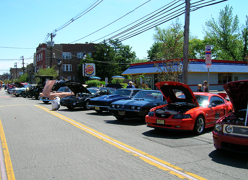 An alternate street view of the car show section of the 2012 May Fest street fair.