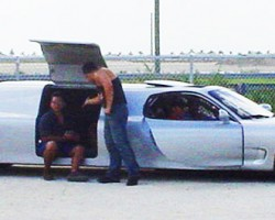 Side view of the 1993 Mazda RX-7 4-door limo.  (Photo credit: Modified Magazine)