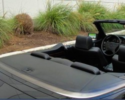 A view of the tonneau cover which folded up to allow convertible top up-and-down operation.  When the top was stationary (either in the open or closed position), the tonneau cover came to rest in this horizontal position as an aesthetic covering.  (Photo credit: Austin Auto Direct)