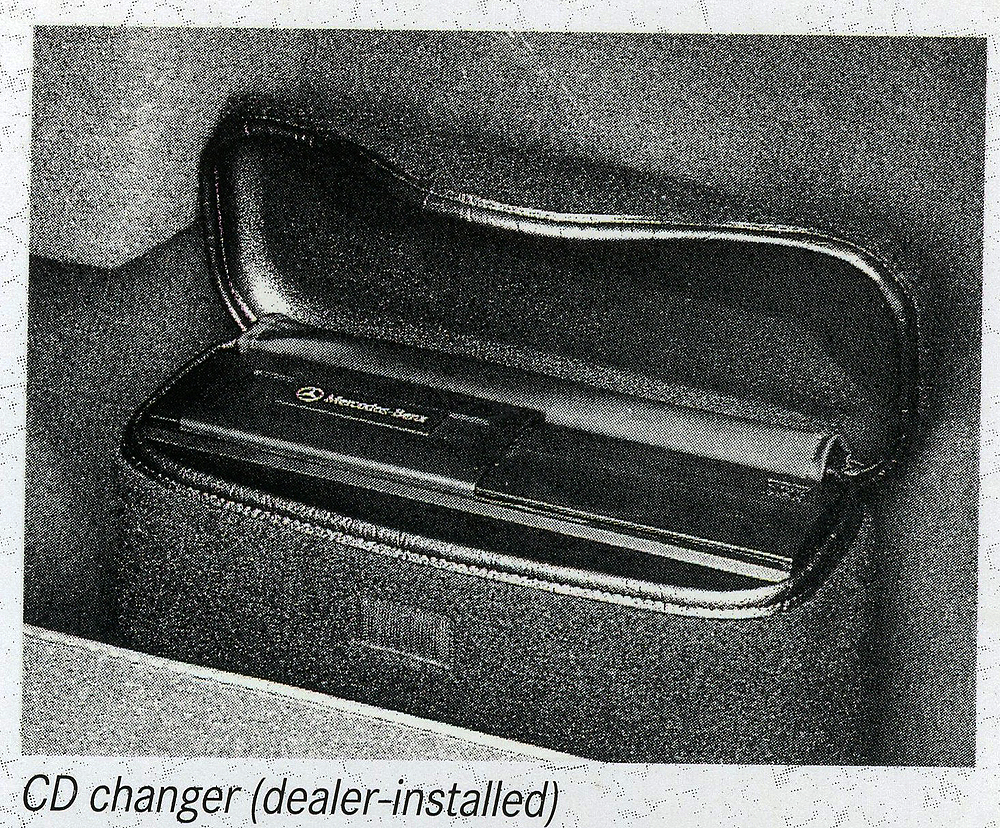 All 124-body Cabriolets were pre-wired for compact disc changers.  If the option was ordered, the c.d. changer unit itself was mounted in the trunk.  (Photo credit: Mercedes-Benz USA)