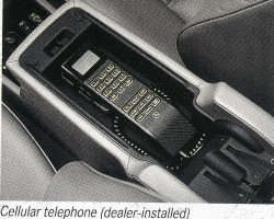 An original U.S. market brochure picture of the optional dealer-installed cellular telephone, which mounted inside the front center armrest.  (Photo credit: Mercedes-Benz USA)