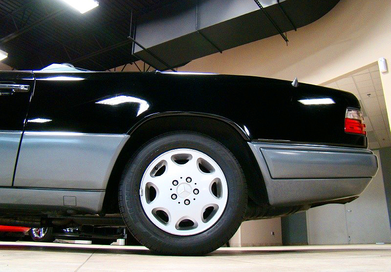 A closeup view of 1994-95 style rear bumper covers (1994 model shown).  While rub strips previously ended shortly after the corner of the bumper, they now extended almost the entire way towards the rear wheel.  (Photo credit: L. Plugg)