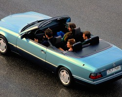 A factory promotional picture for the lowest-priced 124 body Cabrio sold in Europe, powered by a 2.0-liter 4-cylinder engine.  It was badged the 200CE for 1993 and E200 from 1994-on.  Notice this low cost model came standard with steel wheels and plastic wheel covers as shown here.  (Photo credit: Mercedes-Benz Classic Center)