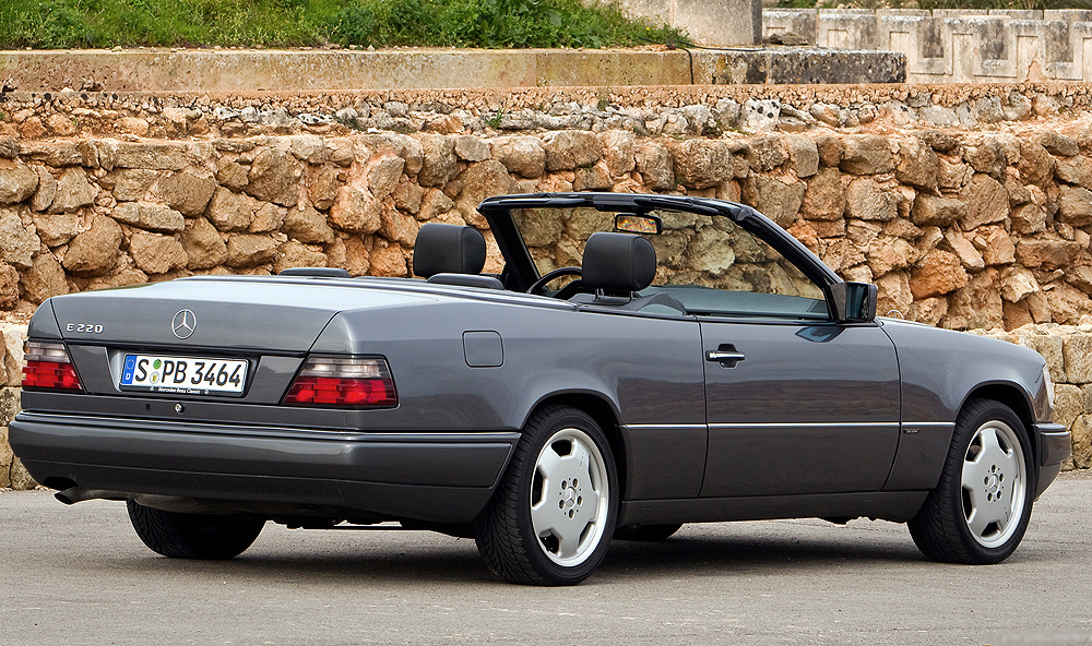 Also introduced for 1993 was a Cabrio model powered by a slightly larger 2.2-liter 4-cylinder.  Here, a 1995 E220 Cabriolet is shown with optional sport package wheels.  (Photo credit: Mercedes-Benz Classic)