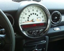 Mini Coopers feature a center-mounted cluster with speedometer, fuel gauge, and other information displayed digitally.
