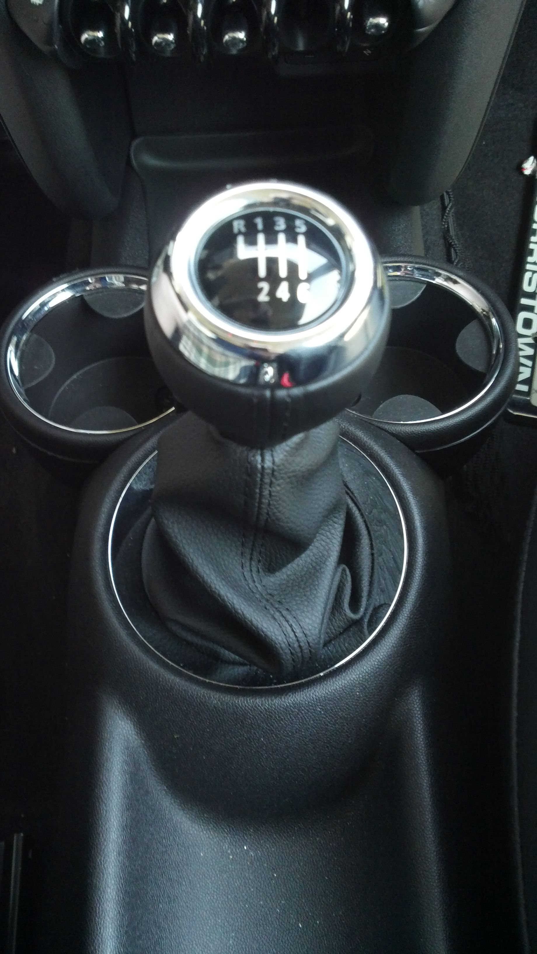 All Mini Coopers, including base models, feature a 6-speed manual transmission standard.  We noticed getting the selector lever into the reverse position required a good deal of force.  (Photo credit: Sean Connor)