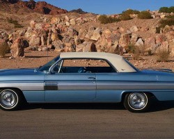 For 1962, General Motors followed Ford's lead with the Thunderbird and introduced vinyl roofs as an option on lower-priced hardtop coupes such as the Oldsmobile Starfire (shown) and Buick Skylark sister version.  (Photo credit: C. Royster)