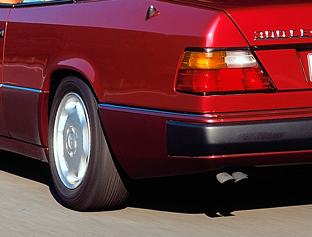 A closer look at the rear bumper rub strips, painted black on all colors of 1993 models.  (Photo credit: Mercedes-Benz Classic Center)
