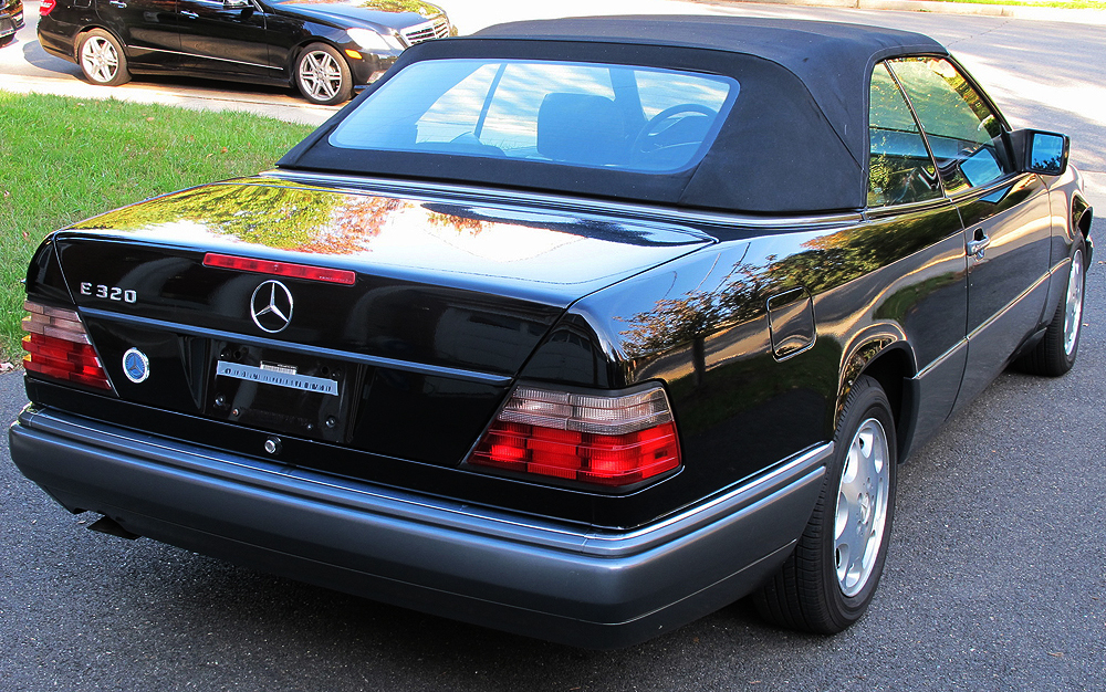 """For comparison, a rear 3/4s top-up view of a """"later"""" 124 body Cabrio.  1995 model shown.  (Photo credit: M. Johannsen)"""