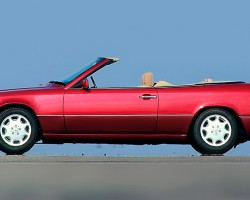 The side view of this 1993 300CE Cabriolet illustrates how bumper rub strips front and rear were highlighted in black on all E-class model variations through 1993.  (Photo credit: Mercedes-Benz Classic Center)